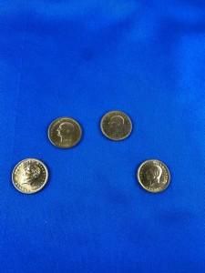 Vier Goldmünzen