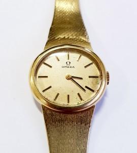 Goldene Uhr OMEGA