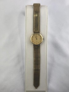 Goldene Herrenarmbanduhr Geneve